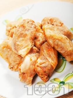 Малки постни зелеви сарми от кисело зеле с ориз, лук и моркови на фурна - снимка на рецептата